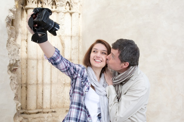 Happy couple taking selfie on the street during europe vacation Premium Photo