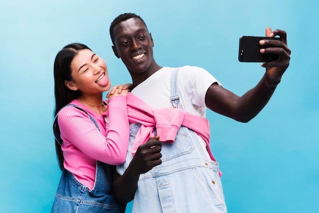 Happy couple taking a selfie Free Photo