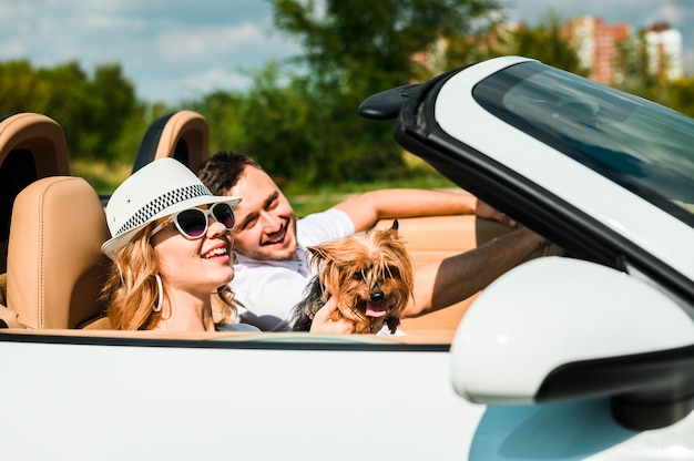 Happy couple travelling with dog Free Photo
