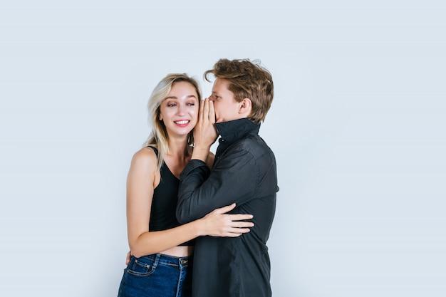 Happy couple whispering something Free Photo