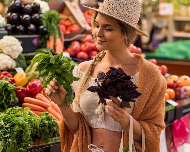 Happy customer buying delicious veggies for meals Free Photo