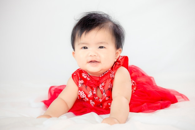 Happy cute asian baby girl in chinese tradition dress ...