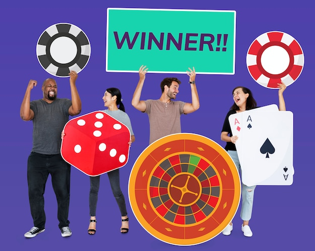Happy diverse people holding casino icons Free Photo
