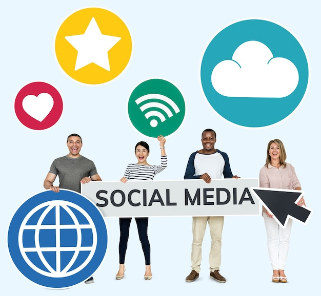 Happy diverse people holding social media icons Free Photo