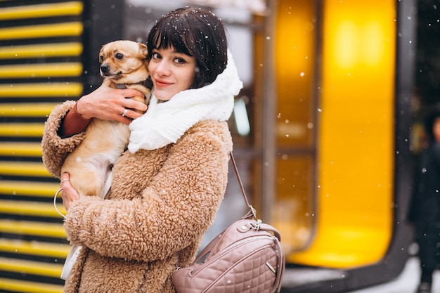 Happy dog owner with little pet Free Photo