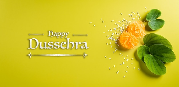 Happy dussehra background concept. green leaf and rice Premium Photo