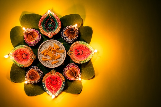 Happy dussehra. clay diya lamps lit during dussehra, indian festival concept. Premium Photo