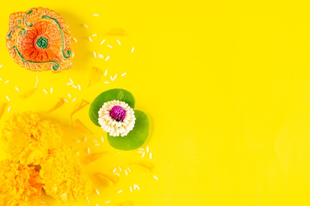 Happy dussehra festival. clay diya and flower on yellow paper with text. flat lay Premium Photo