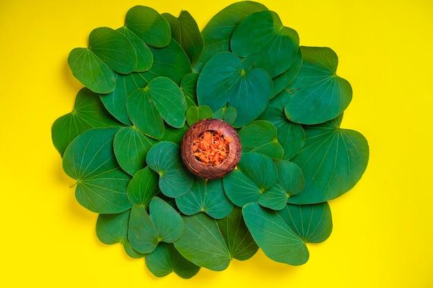 Happy dussehra greeting card , green apta leaf and rice, indian festival dussehra Premium Photo