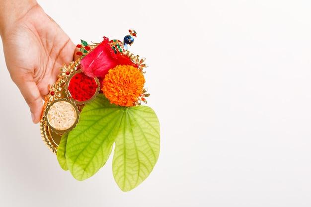 Happy dussehra with green leaf, rice and kumkum Premium Photo
