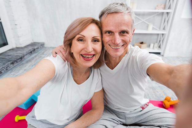Happy elder couple taking self portrait Free Photo