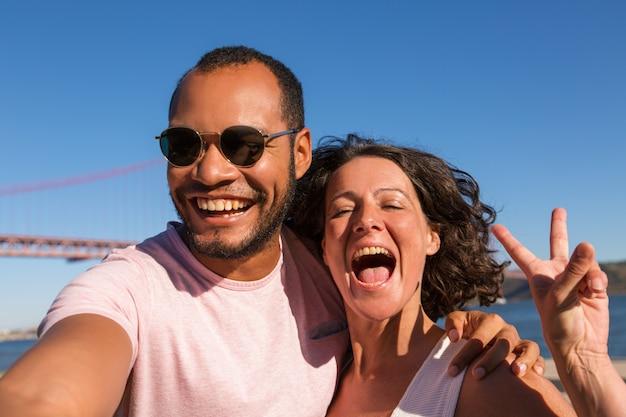 Happy excited couple enjoying vacation Free Photo