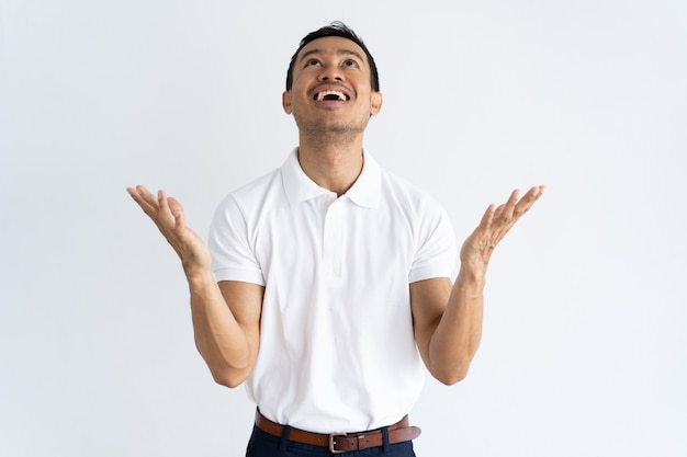 Happy excited guy praying for thank god Free Photo