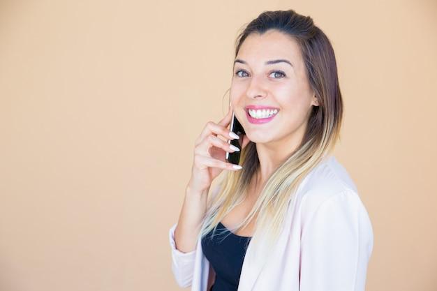 Happy excited lady enjoying phone talk Free Photo
