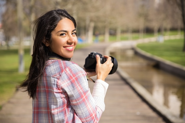 Happy excited tourist shooting landmarks Free Photo