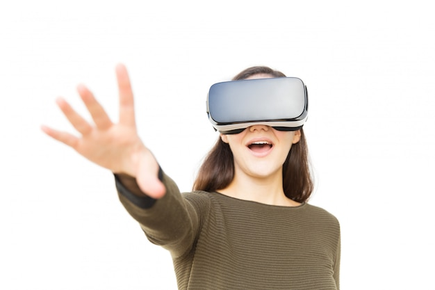 Happy excited woman in vr headset touching air and shouting Free Photo