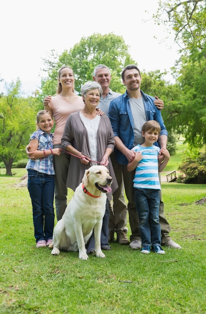 Happy extended family with pet dog at park Premium Photo