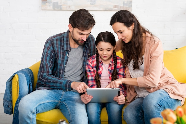 Happy family browsing on the internet Free Photo
