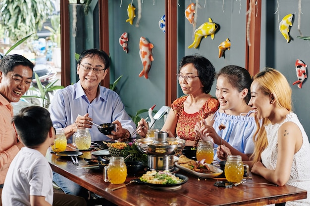 Happy family eating good food Premium Photo