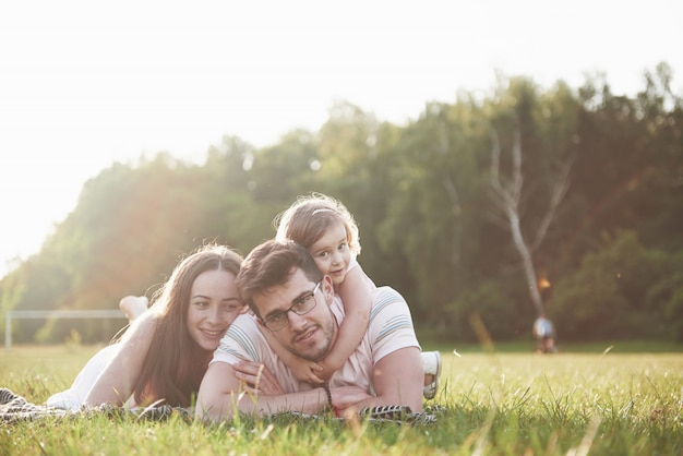 Happy family, father of mother and daughter of baby in the nature at sunset Premium Photo