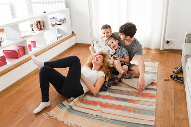 Happy family hanging out in living room Free Photo