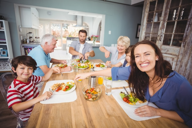 Happy family having breakfast at home Premium Photo