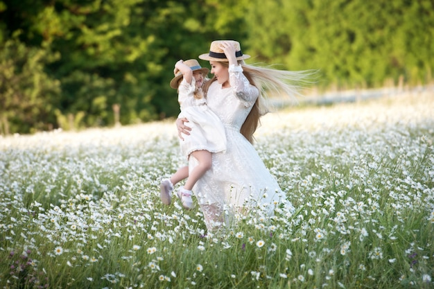 Happy family having fun outdoors. portrait of happy family in countryside. happy people outdoors. family of four in chamomile field. Premium Photo