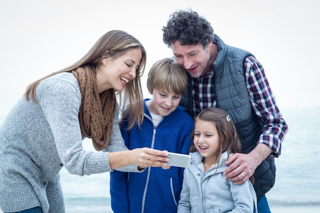Happy family looking in cellphone Premium Photo