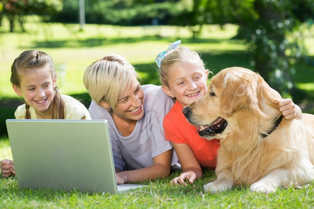Happy family looking at their dog Premium Photo