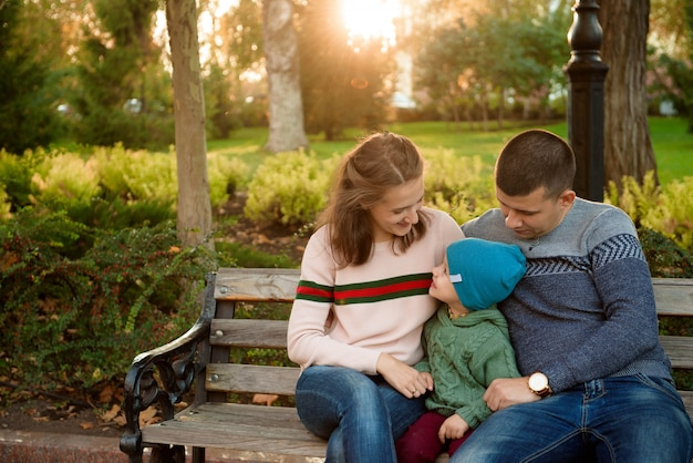 Happy family mother father and baby on autumn walk in the park Premium Photo