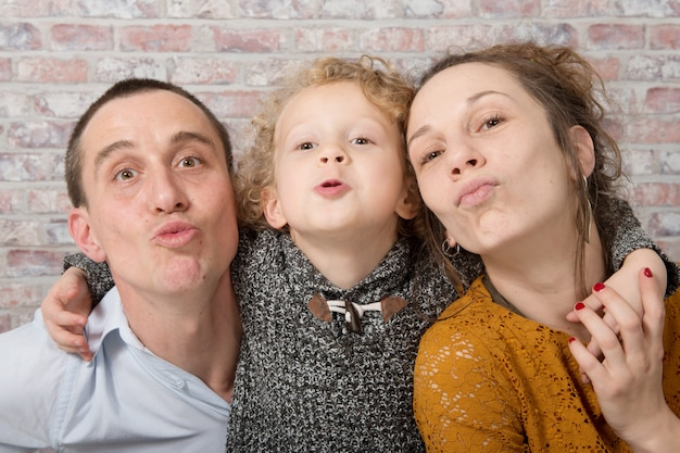 Happy family, mother, father, child  at home Premium Photo