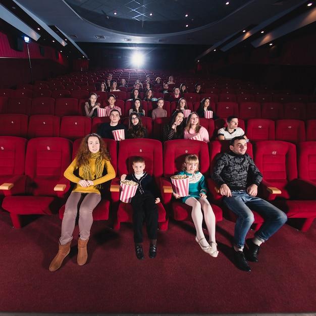 Happy family in the movie Premium Photo