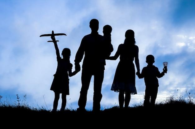 Happy family  on nature silhouette background Premium Photo