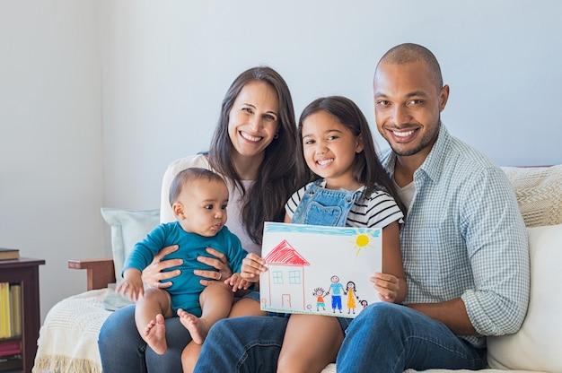Happy family and new home Premium Photo