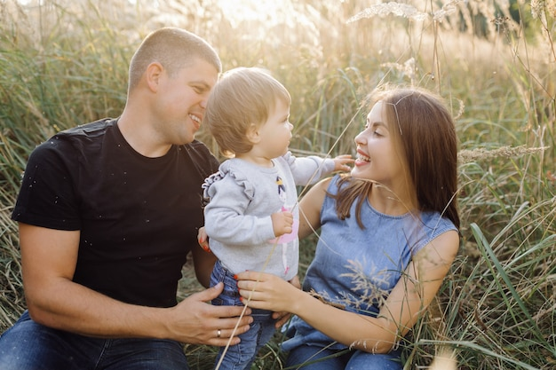 Happy family outdoors spending time together Free Photo