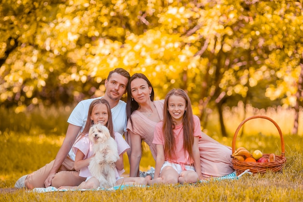 Happy family on a picnic in the park on a sunny day Premium Photo