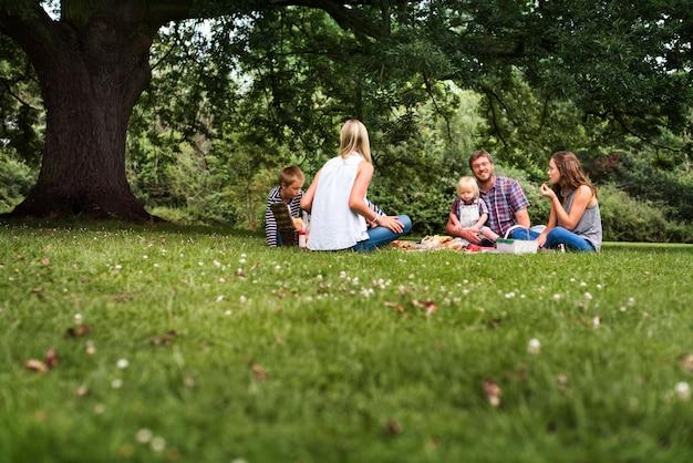 Happy family picnic in the park Premium Photo