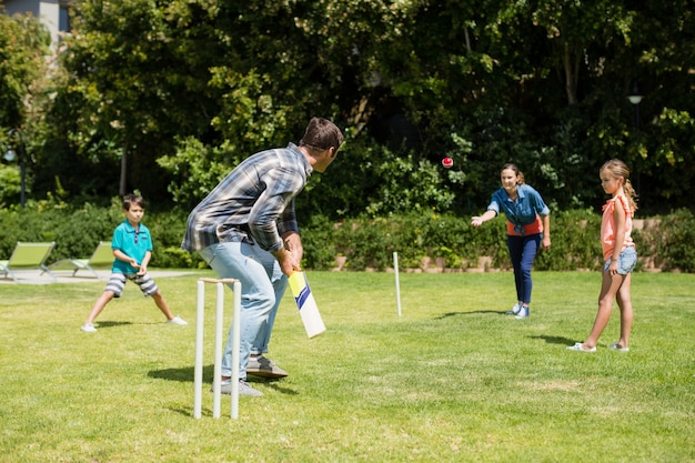 Happy family playing cricket in park Premium Photo