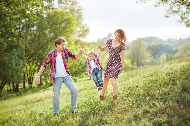 Happy family playing on the nature Premium Photo