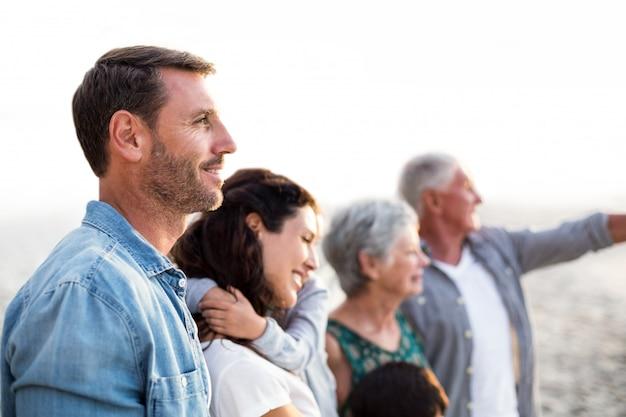 Happy family posing at the beach Premium Photo