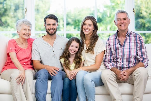 Happy family sitting on sofa at home Premium Photo