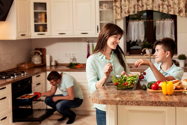 Happy family spending time in the kitchen preparing food Premium Photo