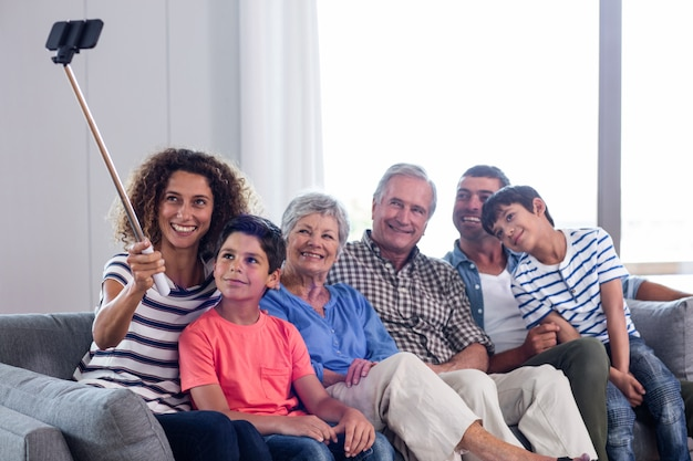 Happy family taking a selfie in living room Premium Photo