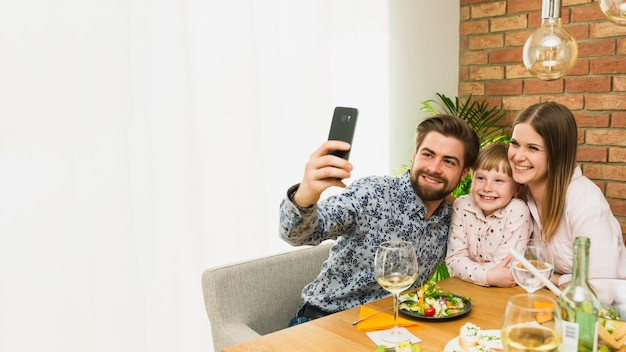 Happy family taking selfie together Free Photo