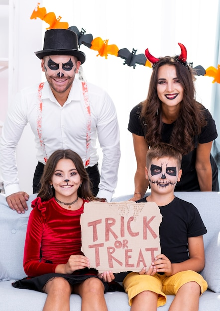 Happy family together posing for halloween Free Photo