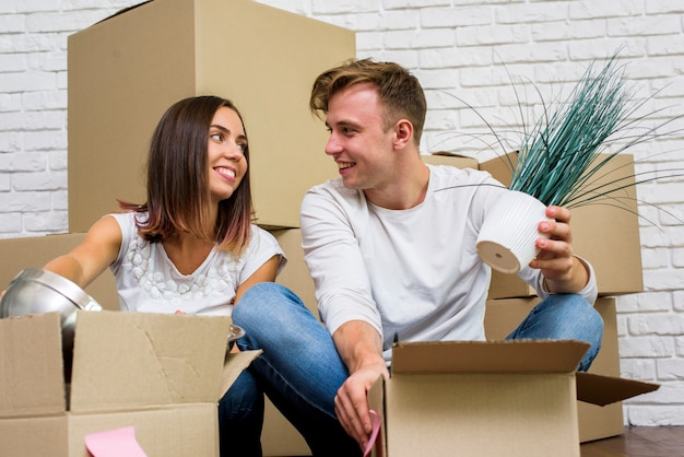 Happy family unpacking boxes Free Photo