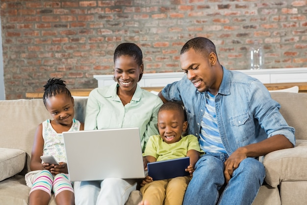 Happy family using technology together Premium Photo