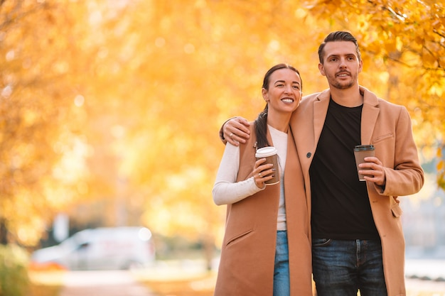 Happy family walking in park on sunny fall day Premium Photo