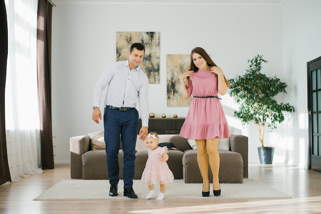 Happy family with little daughter have fun spending their free time in their apartment Premium Photo