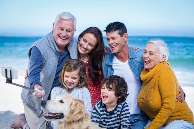 Happy family with their dog taking a selfie Premium Photo